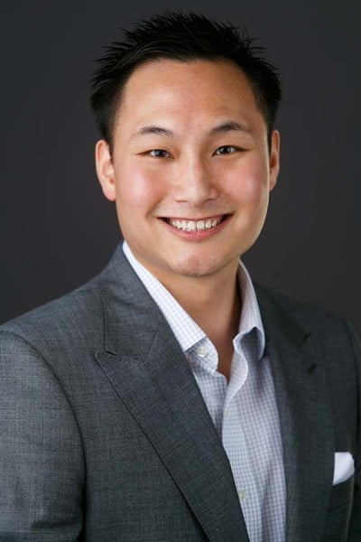 asian man business casual headshot