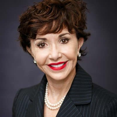 middle aged woman business headshot elegant pearls pinstripe suit