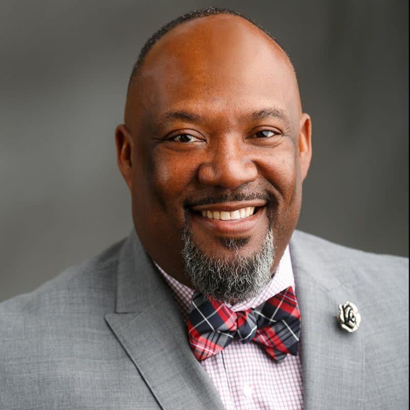black male business headshot bow tie lapel pin bespoke suit