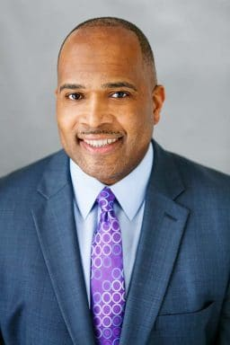 black male business headshot natural light