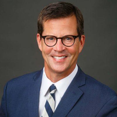 white male headshot stripe tie glasses