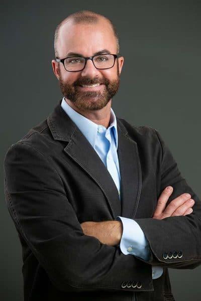 confidant white male headshot arms crossed glasses