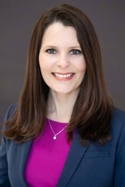 business headshot white female brunette navy jacket pink blouse